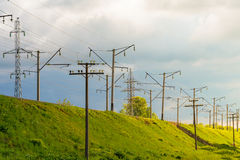 The electrified railway goes into the distance against a blue sky Stock Photography