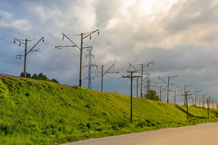The electrified railway goes into the distance against a blue sky Royalty Free Stock Photography