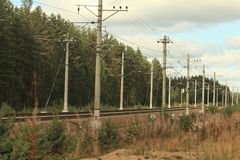 Electrified railway going into the distance Royalty Free Stock Photo