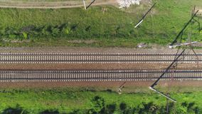 Electrified railway track. The camera moves along the rail direction. Shooting from the top to the bottom stock video