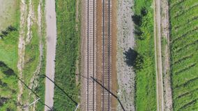 Electrified railway track. The camera moves along the rail direction. Shooting from the top to the bottom stock video footage