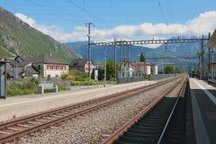 Electrified railway tracks. Vernayaz, Martigny, Switzerland Stock Image