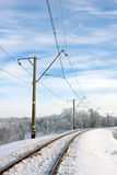 Electrified railway at winter Stock Photos
