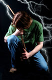 Electrified Rock. Rock guitarist against black background and lightning bolts Royalty Free Stock Photo