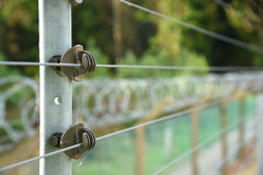 Electrified security fence Royalty Free Stock Images