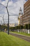 Electrified tramway wires and traditional yellow tram car in the distance, Budapest, Hungary Stock Photo