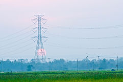 An electriticity pylon in front of the sunset Stock Photography