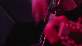 Electro-acoustic guitar closeup stock footage