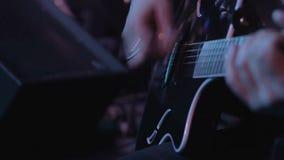 Electro-acoustic guitar closeup stock video footage