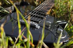Electro guitar lying in grass Stock Photography