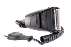 Electro-razor. The black electrorazor with a cord and a plug on a white background, closeup, isolated Stock Images