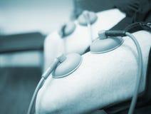 Electro stimulation muscle injury strain pain treatment Stock Photo