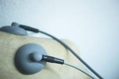 Electro stimulation used to treat pain Stock Photo