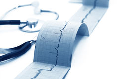 Electrocardiogram with doctors stethoscope Stock Photography