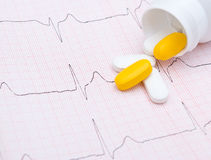 Electrocardiogram graph and pills Royalty Free Stock Image