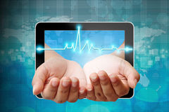 Electrocardiogram on hand Royalty Free Stock Image