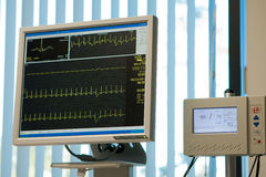 Electrocardiogram monitor and blood pressure Stock Photos
