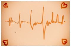 Electrocardiogram orange background Stock Images