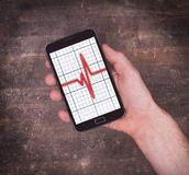 Electrocardiogram on a smartphone - Concept of healthcare Stock Image