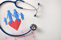 Electrocardiogram stethoscope and cutout heart on white table to Royalty Free Stock Photo