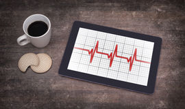 Electrocardiogram on a tablet - Concept of healthcare Stock Image