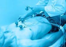 Electrocardiogram taking, blue toning Stock Image