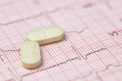 Electrocardiograph with pills Royalty Free Stock Photo