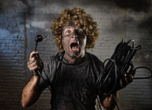 Electrocuted man with cable smoking after domestic accident with dirty burnt face shock electrocuted expression Stock Photos