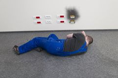 Electrocuted a man lying on the ground Royalty Free Stock Images