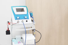Electrodes electric massage medical equipment in physiotherapy r. Oom Royalty Free Stock Image