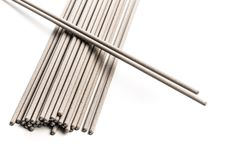 Electrodes for welding isolated on a white background. Accessories of welder stock images