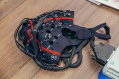 The electroencephalogram EEG head cap on wooden table royalty free stock image