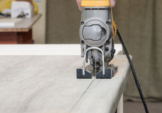 Electrofret. Cut the kitchen countertop for installation of kitchen equipment stock photography