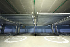Electrolifts inside indoor two-level parking. With numbers on floor for many cars Royalty Free Stock Image