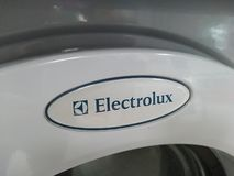 Electrolux washing machine. Berlin, Germany - June 25, 2018: Electrolux emblem on a washing machine. Electrolux AB is a Swedish multinational home appliance stock images