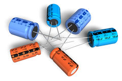 Electrolytic capacitors. Set of different electrolytic capacitors isolated over white background Stock Photos