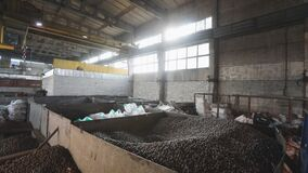 Electromagnetic crane with metal balls,Big Industrial Building With Moving Electromagnetic Cranes, production of balls