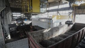 Electromagnetic crane with metal balls, loading into a wagon, production of balls, manufacture of bearings
