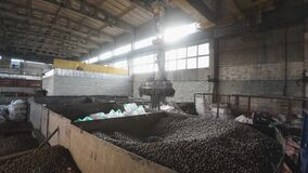 Electromagnetic crane with metal balls, With Moving Electromagnetic Cranes, Big Industrial Building, production of balls