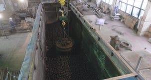 Electromagnetic overhead crane loads balls into a truck
