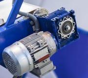 Electromechanical drive belt. Electric motor with gear driven conveyor belt Stock Photo