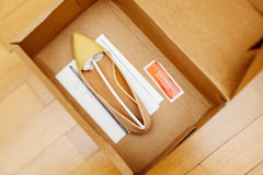 Electronic article surveillance inside a box of women shoes  Stock Photo