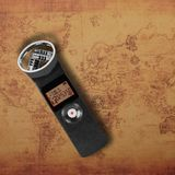 Electronic audio device - Top view Portable digital Recorder map background. Electronic audio device - Top view Portable digital Recorder on a old world map stock photography