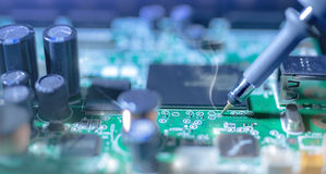 Electronic background: soldering of computer motherboard Stock Photography