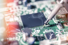 Electronic background: soldering of computer motherboard Royalty Free Stock Image