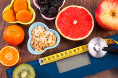 Electronic bathroom scale, centimeter and stethoscope, healthy food, slimming and healthy lifestyles concept Stock Image