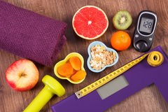 Electronic bathroom scale, glucometer, centimeter, healthy food and dumbbells for fitness, healthy lifestyles, diabetes and slimmi Stock Images