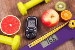 Electronic bathroom scale and glucometer with result of measurement, centimeter, healthy food and dumbbells, healthy lifestyles, d Stock Image