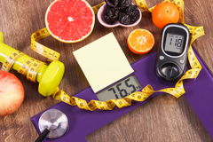 Electronic bathroom scale and glucometer with result of measurement, healthy food and dumbbells, healthy lifestyles, diabetes and Stock Photo