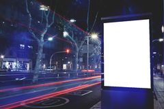 Electronic blank billboard with copy space for your text message or content, public information board with cars lights on backgrou Stock Image